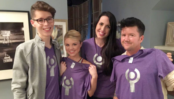 Amanda Saenz (interACT Youth Member) , Bailey De Young (MTV's Faking It), Emily Quinn (interACT Youth Coordinator) on the set on MTV's Faking with interACT tshirts.