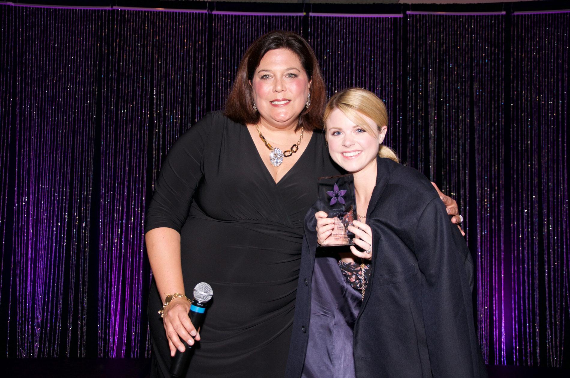 interACT executive director present actress Bailey De Young with an AIS-DSD support group award